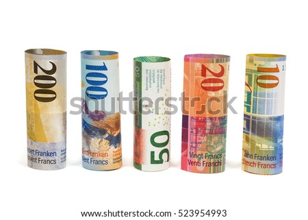 Set of rolled swiss franc banknotes isolated on white background with clipping path