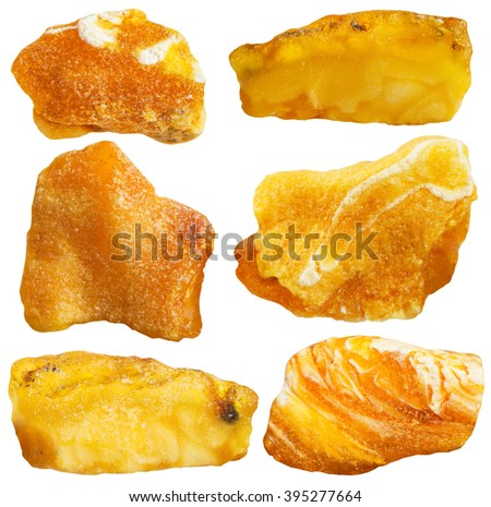 set of rough amber mineral gem stones isolated on white background - stock photo