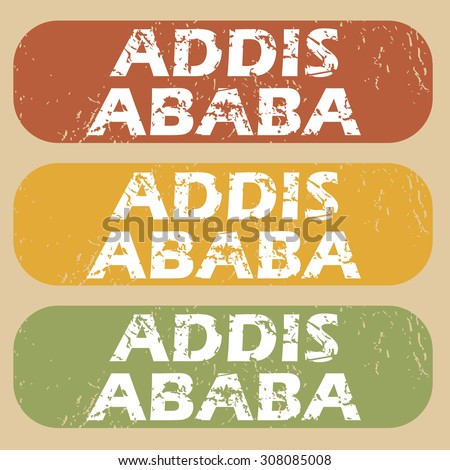 Set of rubber stamps with city name Addis Ababa on colored background - stock photo