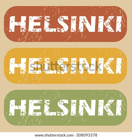 Set of rubber stamps with city name Helsinki on colored background - stock photo