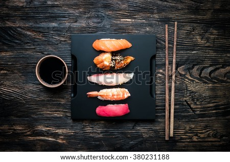 set of sashimi sushi with soy and chopsticks - stock photo