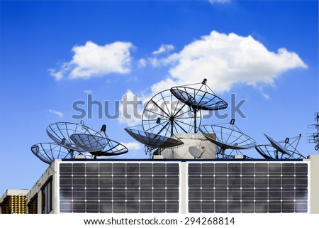 Set of Satellite dish and TV antennas on the house roof communication technology network on building under blue sky. - stock photo