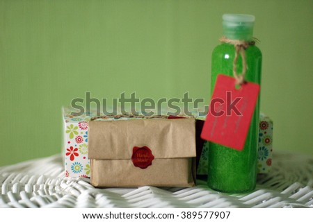 set of shampoo and soap on a green background