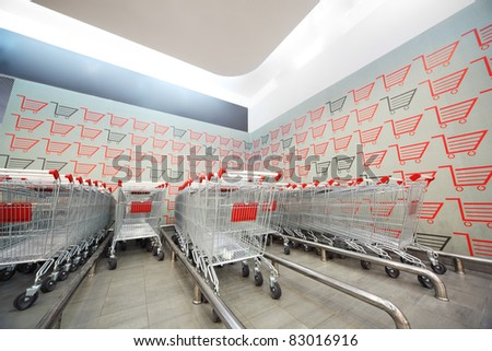 Set of shopping trolley folded into each other in supermarket - stock photo