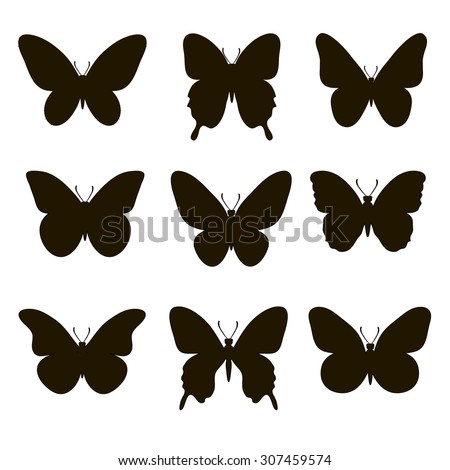 Set of silhouettes of butterflies on a white background.  - stock photo