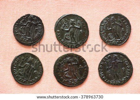 Set of six ancient Roman coins on display - stock photo