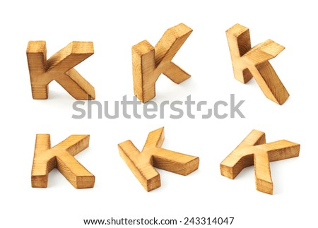 Set of six block wooden capital K letters in different foreshortenings isolated over the white background