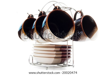 Set of six teacups and dishes, different angle, selective focus - stock photo