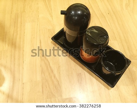 Set of soy sauce bottles on wooden table background. Top view - stock photo