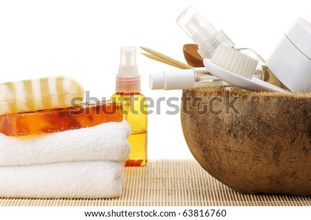 Set of SPA accessories on wooden mat against white background.