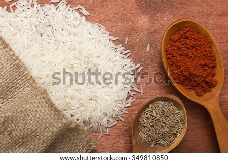 Set of spices for cooking rice on a kitchen table surface. - stock photo