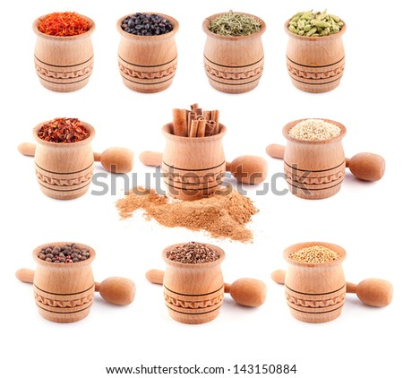 Set of spices in wooden  bowls isolated on a white - stock photo