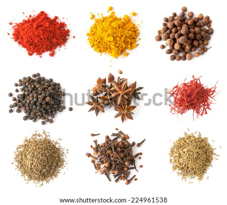 Set of spices (red and black pepper, allspice, saffron, curry, anise, cloves, cumin, coriander) isolated on white, top view - stock photo