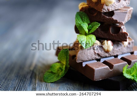 Set of spicy chocolate on wooden background - stock photo