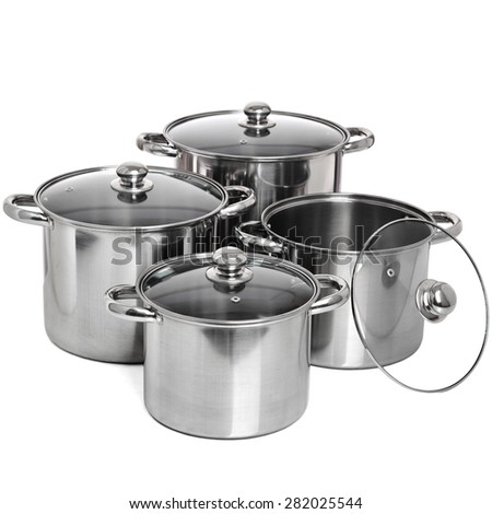Set of 4 stainless pots  isolated on white - stock photo