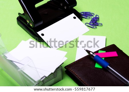 side view office set. set of stationery for office hole puncher paper clips box with blanks side view r