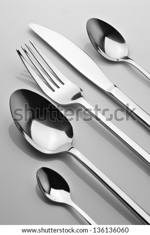 Set of steel fork, knife and spoons. B&W image. - stock photo