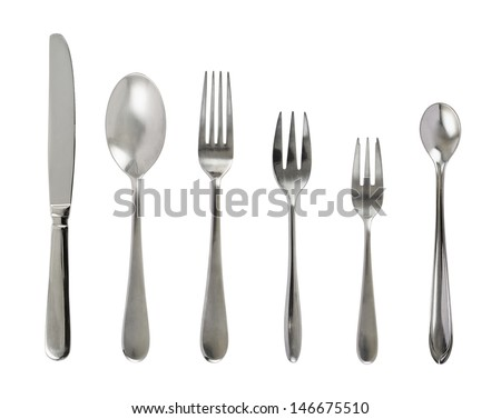 Set of steel metal table cutlery isolated over white background - stock photo