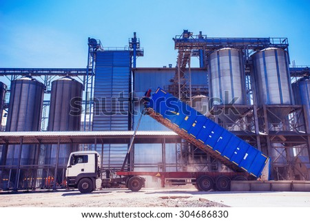 Set of storage tanks cultivated agricultural crops processing plant. - stock photo