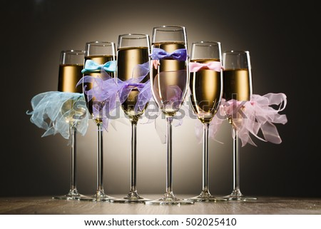Set of stylized glasses with champagne for wedding party