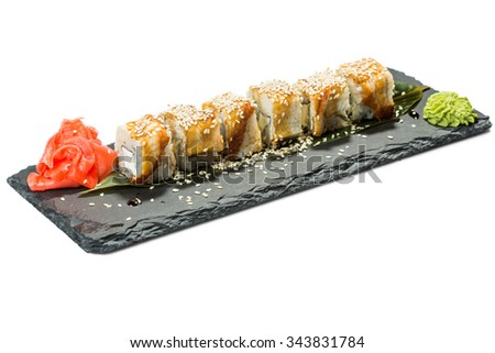 set of sushi on black slate substrate, isolated white background