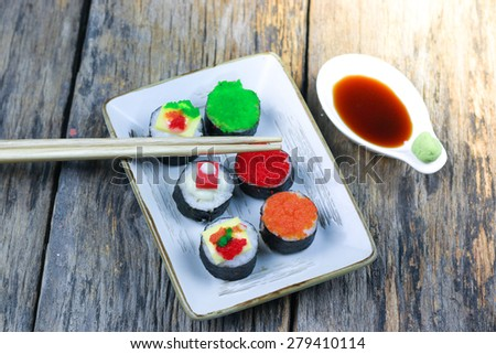 Set of sushi on wood background - stock photo