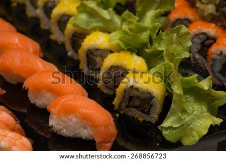 Set of Sushi roll, with shadows and reflection on a black background.