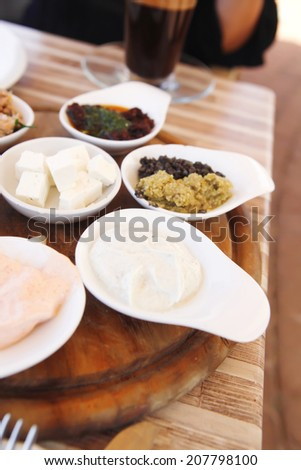 set of tapas on wooden table outside cafe - stock photo