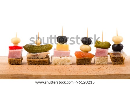 Set of tasty canape on a white background - stock photo