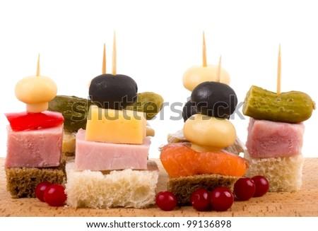Set of tasty canape on a white background - stock photo