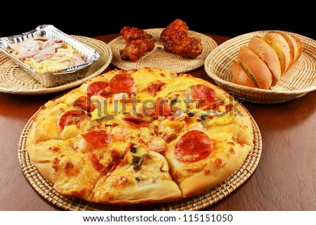 Set of tasty pizza on a wooden table - stock photo