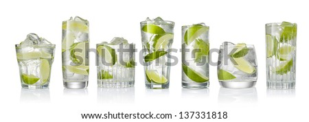 Set of the cocktails with ice and lime slice isolated on white background