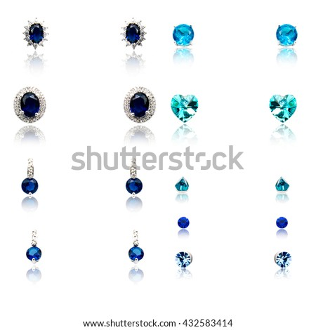 Set of the nine pairs of diamond earrings isolated on white