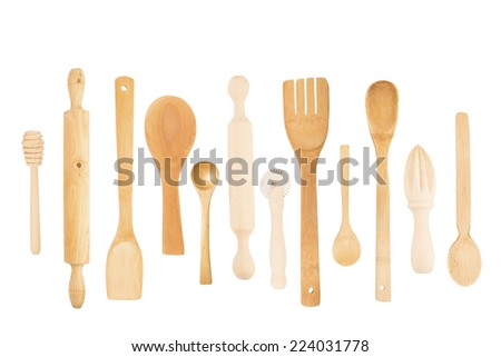 Set of the wooden kitchen utensils isolated - stock photo
