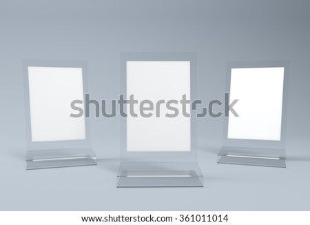 Set of three acrylic table tents with white paper inside - stock photo