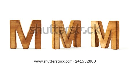 Set of three block wooden capital M letters in different foreshortenings isolated over the white background - stock photo