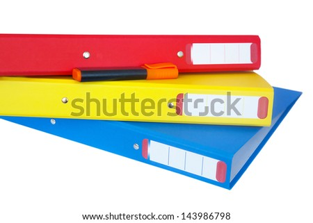 Set of three bright- colored folders with an orange marker - stock photo