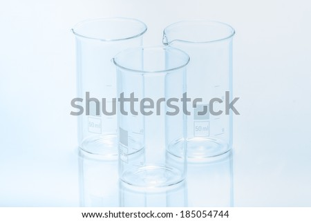 Set of three empty temperature resistant cylindrical beakers for measurements