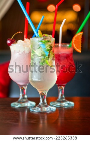 Set of three healthy nonalcoholic cocktails berries and classic mohito - stock photo