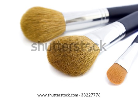 Set of three makeup brushes for face powder, concealer and eye shadow. Isolated on white background.