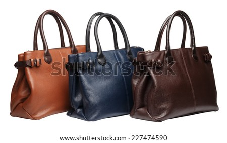 Set of three natural leather female purses different colour terracotta, brown and blue) isolated on white background - stock photo