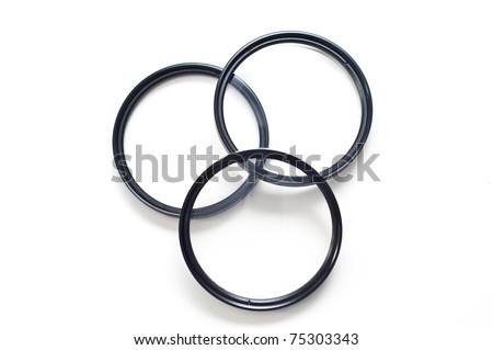 Set of three screw-in photographic lenses - stock photo