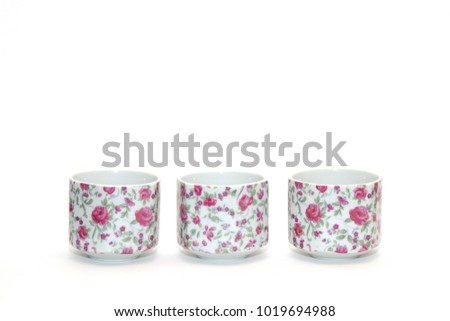 Set of three vintage teacup on a white background