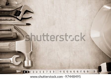 set of tools and instruments on wood texture background