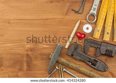 Set of tools and instruments on wooden background. Different kinds of tools for household chores. Home repairs. Father's Day. - stock photo