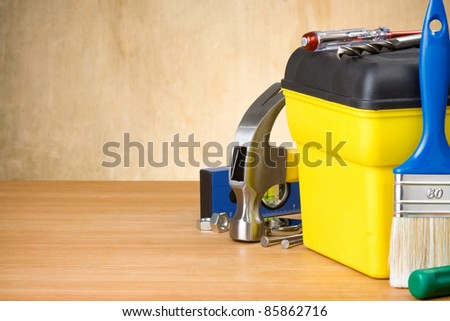set of tools and toolbox on wood background - stock photo