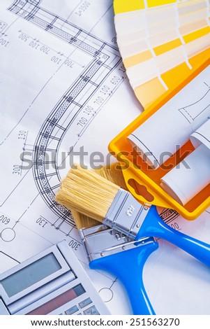 set of tools blueprints paintbrushes calculator paint can color palette - stock photo