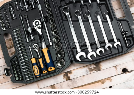 Set of tools in a black suitcase - stock photo