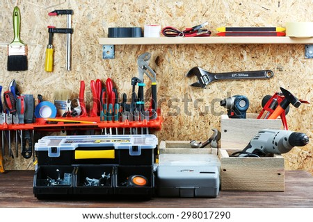 Set of tools in workshop - stock photo