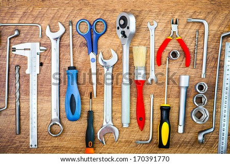 set of tools on a wooden background - stock photo
